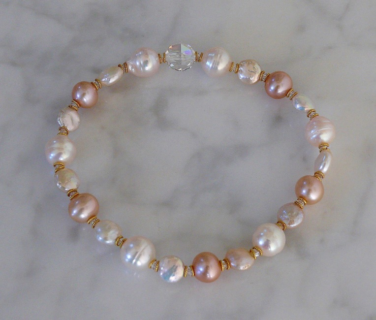 Stretch bracelet from the Petal Plush Pearls Collection by Arpaia Jewelry with cultured pearls, Swarovski crystal, and 22kt Gold accents.